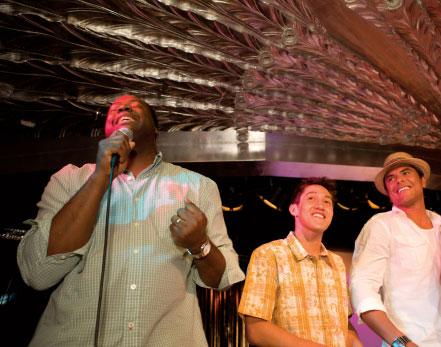 Man with microphone performing karaoke.