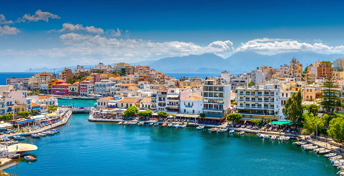 Skyline with boats docked in Crete.