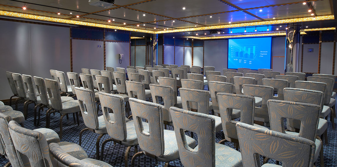Conference room with projector and seating.