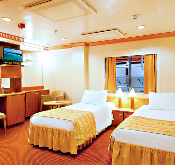 Interior cabin stateroom on carnival miracle.