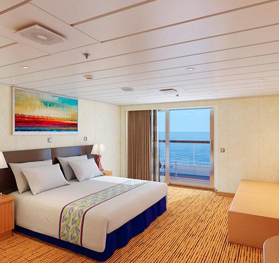 Junior suite stateroom interior on Carnival paradise.
