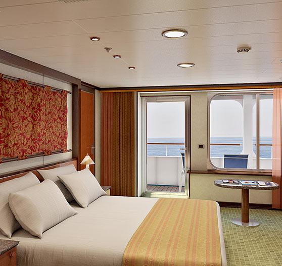 Grand suite stateroom interior on Carnival Sensation.