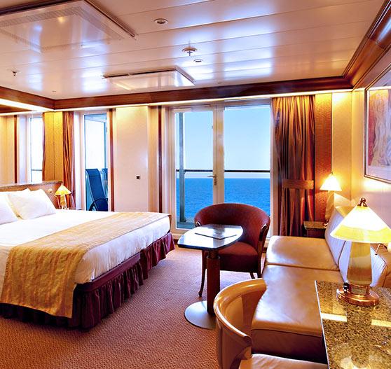 Ocean suite stateroom interior on Carnival Spirit.