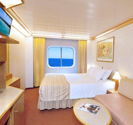 Ocean view stateroom interior on Carnival Spirit.