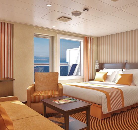 Junior suite stateroom interior on carnival valor.