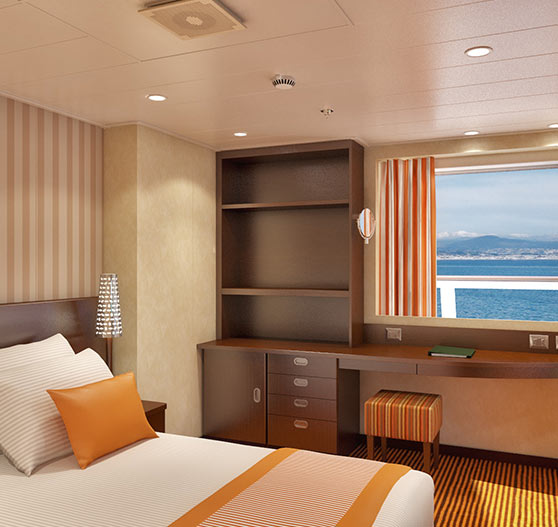 Captain suite stateroom interior on carnival valor.