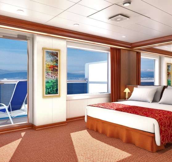 Interior of junior suite stateroom on Carnival Conquest.
