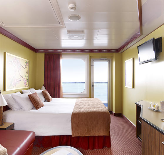 Interior of balcony stateroom on Carnival Dream.
