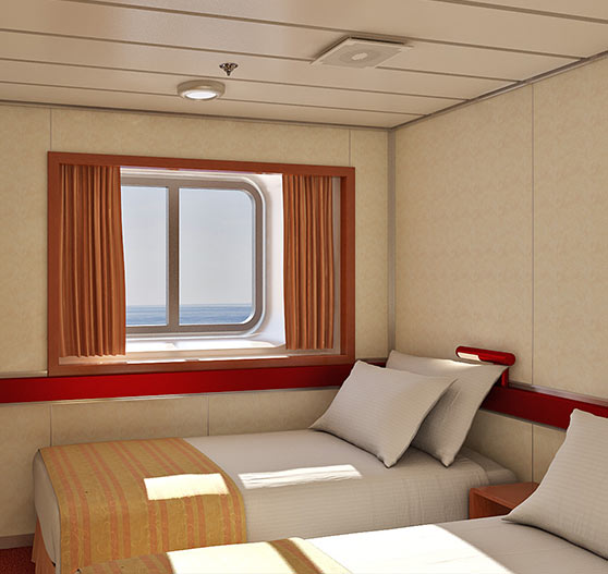 Interior of aft extended balcony stateroom on Carnival Ecstasy.