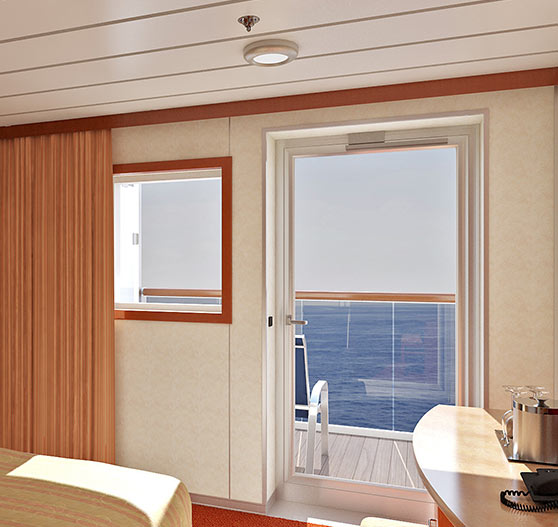 Interior of balcony view stateroom on Carnival Ecstasy.