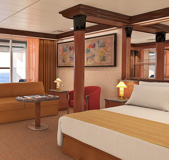 Interior of extended balcony grand suite stateroom on Carnival Ecstasy.