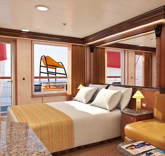 Interior of junior suite stateroom on Carnival Ecstasy.